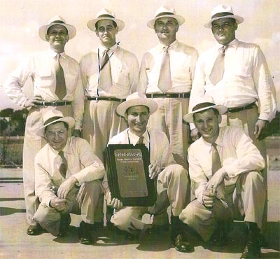 The 1952 Pine Mine 1, Pine Township Coal Company first aid team, which came in first place in the North Central Safety Association, held at the Indiana County Fairgrounds: Front: Michael Buriok, Steve Stupic, Michael Kuzemchak; Back: Joseph Leone, Steve Popovich, John Compardo, George Slonac.