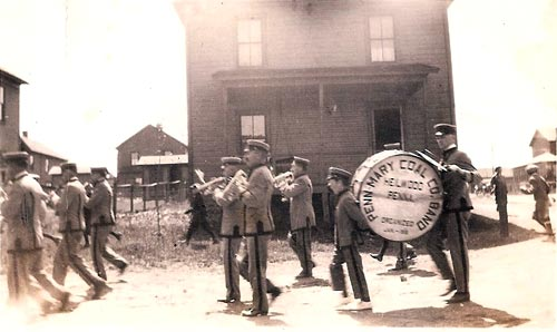 The Heilwood Band marching east on Second Street with First Street in the background, circa 1938.