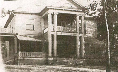 The Big House, circa 1916. Notice the addition of two canvas awnings on either side of the main entrance.