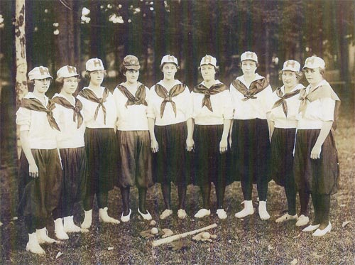 "(L-to-R): Pearl ""Barney"" Muffley (3rd Base); Mildred ""Erlpa"" Barndollar (Outfield); Elsie ""Swenski"" Lunn (2nd Base); Bertha ""Bert"" Gromley (1st Base);  Carrie ""Cot"" Henry (Pitcher); Lottie ""Lot"" Vanderhoof (Catcher); Gert Giles (Shortstop); Irene ""Shorty"" Vanderhoof (Outfield); Margaret Auton (Outfield)"
