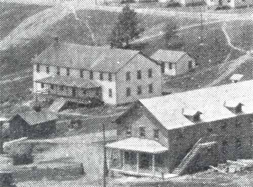 A view of the Heilwood Coal Company's Boarding House #1 (left), showing the wash house in the rear.