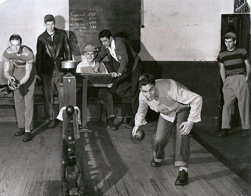 Duck pin bowling at DeMay's Barber Shop (circa 1950)