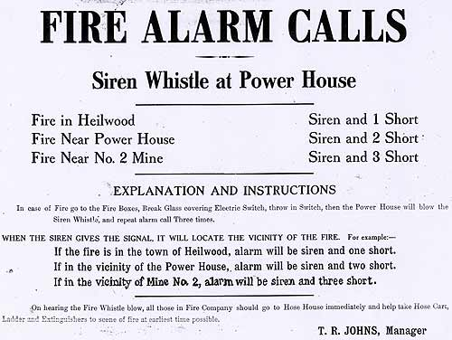 A fire alarm sign indicating what different sirens meant.
