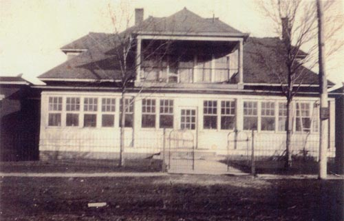 "This photo, circa 1920, shows that the original hospital underwent some modifications. The open front porch was enclosed to possibly create a larger waiting room, while the roof over the second story windows was extended. The ""Penn Mary Hospital"" sign is no longer visable, but it could possibly be hidden by the extended roof."
