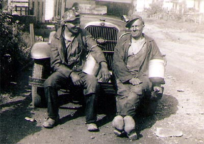 Two Heilwood miners, a father and son, at the end of a day's work.