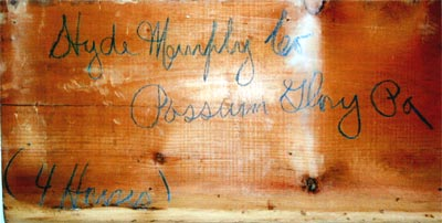 "Board found in house #3 (Staff Street) while the house was being remodeled. It reads: ""Hyde Murphy Co. Possum Glory, Pa."" (ca. 1908-1912)"
