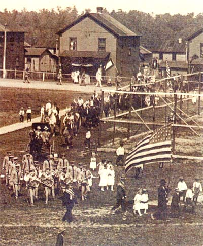 The Heilwood Band marching in front of a parade (circa 1918).