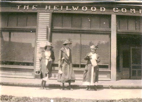 Three women standing outside the Heilwood Company Store, circa 1910.
