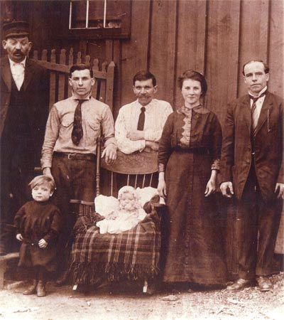 Another Eastern European family in front of their Heilwood shanty.