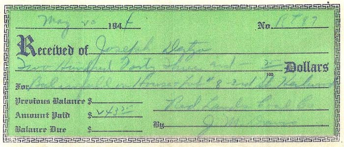 A miner's final payment for one of the houses (1944)