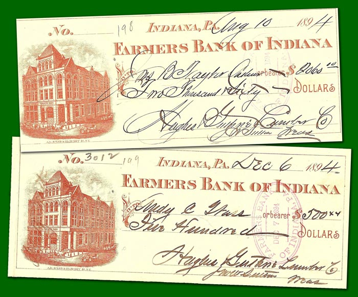Checks from Guthrie's lumber company, dated 1894.