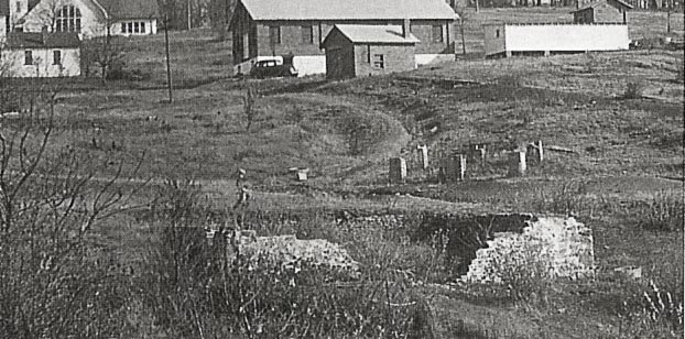 1944 photo showing remnants of The Barn foundation in the foreground; stone pillars on the right side that probably belonged to the coal tipple; a smaller building in the background that was the hoist house