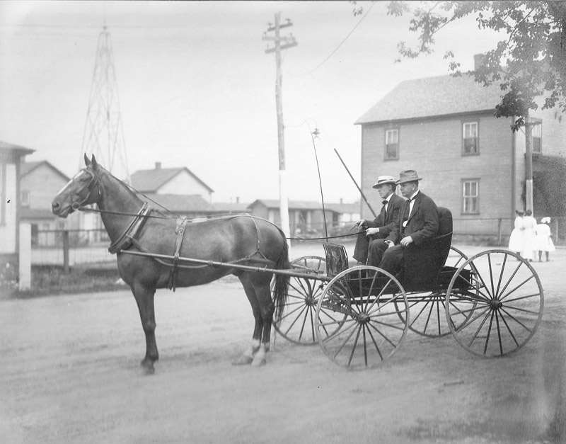 Heilwood's first two doctors, McHenry and Gourley, riding in a horse-drawn buggy.