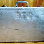 Monogrammed, aluminum suitcase used by a Heilwood resident who served in the military during World War II.