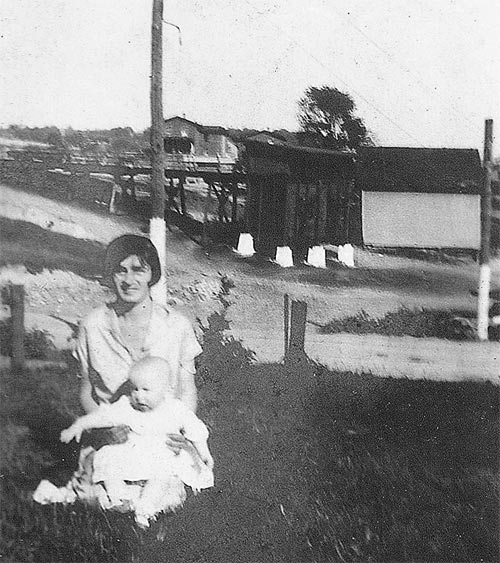 Peggy Jusko and baby with the Ice House in the background (to the right of the tipple) in 1927.